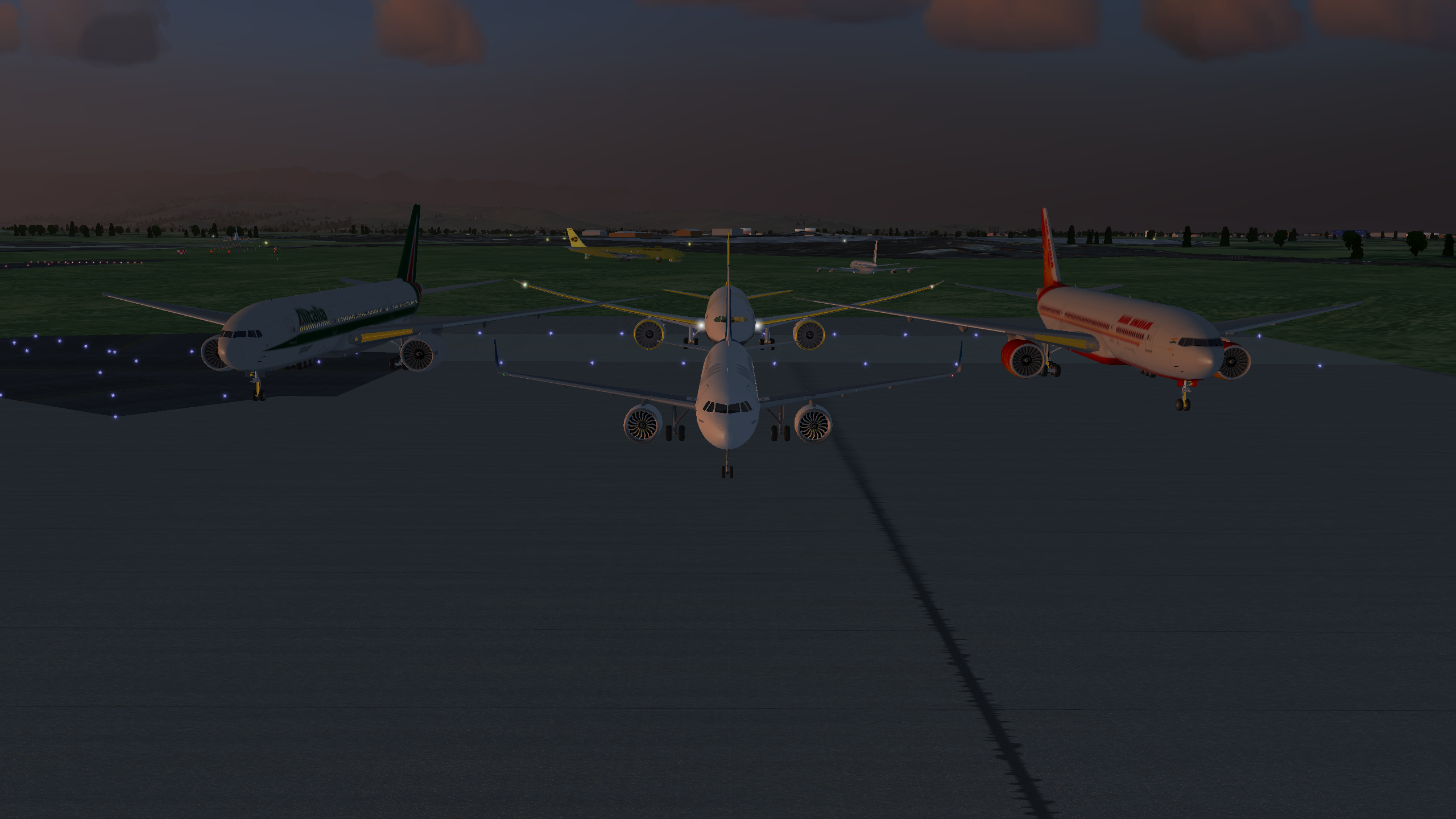 Aircraft grouped on ground (777, 787, A320)